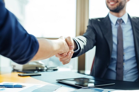 Close up of business handshake in the office